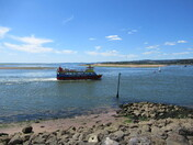 """""""Stuart Lines Cruises"""" on the Exmouth sea-front at low tide"""