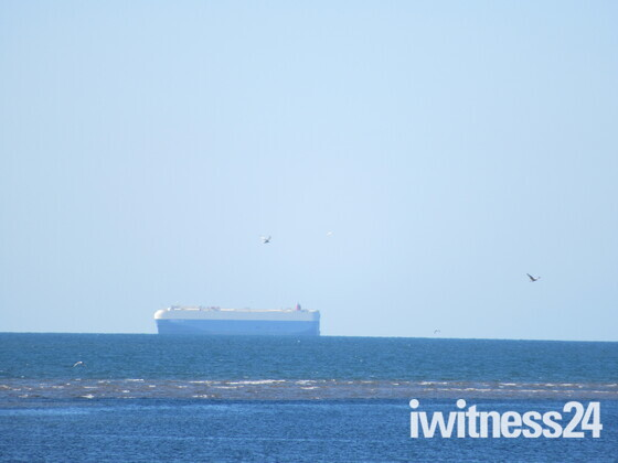 A huge boat seen on the horizon from Exmouth sea-front