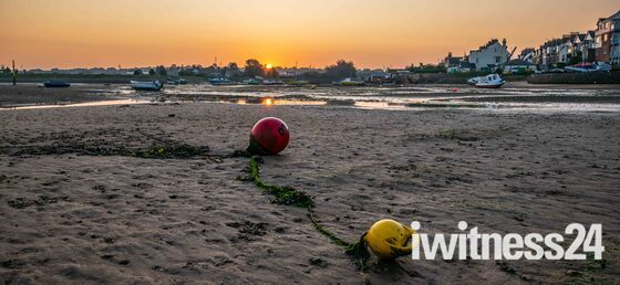 Sunrise over the Gut, Exmouth and the Buoy Cat.