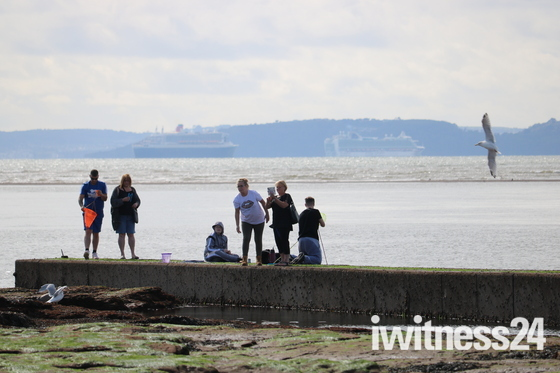 QE 2 and others off Exmouth beach