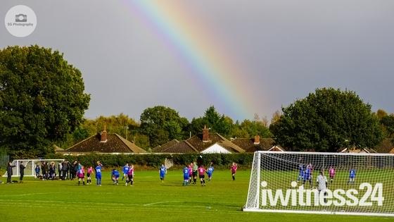 Rainbow overlooking football