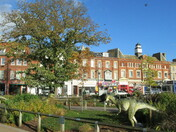 Exmouth Strand model dinosaurs in amongst the autumn scenery.