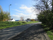 A sunny scene along the main road, passing Exmouth Railway Station.