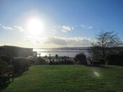 A view of Exmouth sea-front sun shining on the sea, from Beacon Hill