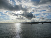 Sun shines on the sea when looking towards Dawlish Warren, from Mamhead Sluipway (Exmouth)