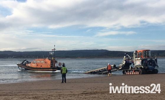 Lifeboat launched off Exmouth beach