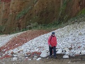 Man building up the base of Hunstanton cliffs every day