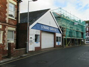 "The new building between trhe fomer ""Thomas Tucker"" and ""Strand Garage"" (Exmouth)"