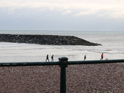 Tiny people on a railing, Sidmouth