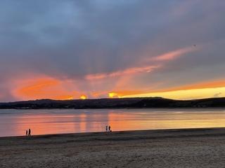 Sunset stroll along Exmouth Beach