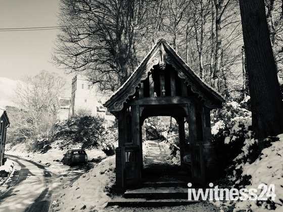 Playford Gate leading to St Mary's in the snow
