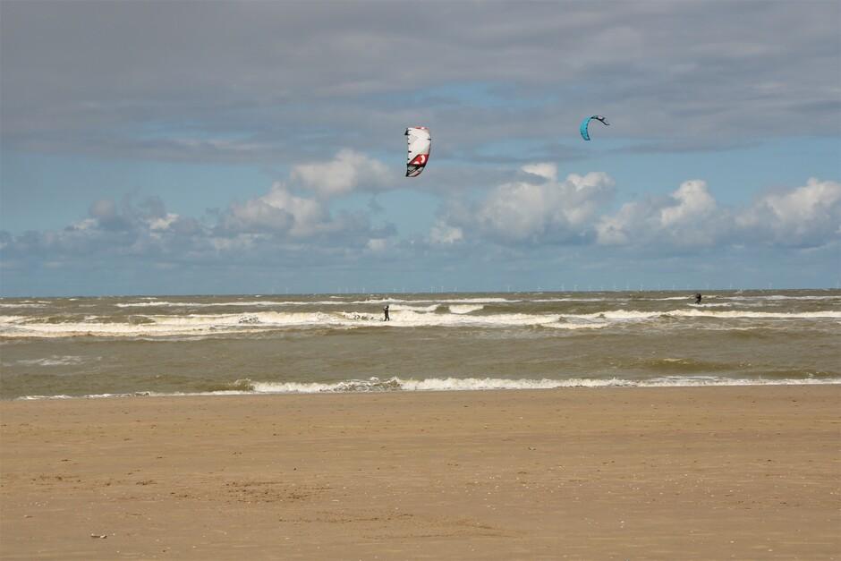 Wolken, zon, zee, strand