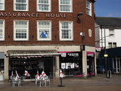 """Exmouth Strand decorated with St. George's Day flags outside """"Crusty Cob Co."""""""