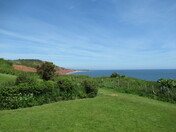 A view from Sandy Bay over the red cliffs towards Budleigh Salterton