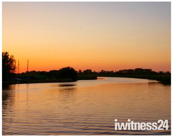 Sun setting on river boat