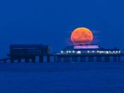 Harvest moon rise over Cromer pier