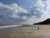 Little girl on big beach
