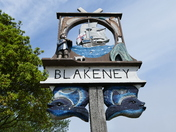 PROJ 52. LOOKING UP.   AT THE BLAKENEY VILLAGE SIGN
